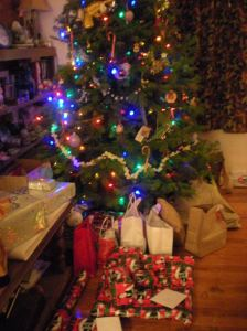 Traditional Pagan Yuletide Evergreen, all decorated, with gifts underneath.