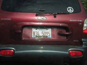 foreign license plates, peace sign car stickers