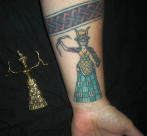 Minoan Snake Goddess, left. My left arm, right.