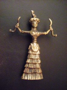 She's been found in a variety of forms and made from several types of materials. This replica is brass.